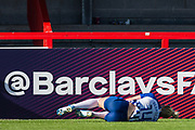 Danique Kerkdijk (Brighton) lying injured near the hordings following the goal from Adelina Engman (Chelsea) during the FA Women's Super League match between Brighton and Hove Albion Women and Chelsea at The People's Pension Stadium, Crawley, England on 15 September 2019.