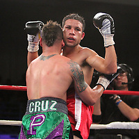 "Orlando Cruz (green trunks) , ranked as the #4 Lightweight by the WBO, fights against Jorge Pazos at the Kissimmee Civic Center in Kissimmee, Florida, on Friday, October 19, 2012. The Puerto Rican Cruz recently described himself as ""a proud gay man"" and the first active boxer having pronounced so, in boxing history. Cruz won the fight in a 12-round decision. (AP Photo/Alex Menendez)"