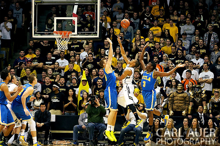 January 12th, 2013: A Cousy Award player to watch, Colorado Buffaloes sophomore guard Spencer Dinwiddie (25) is fouled as he floats a shot up over the UCLA defense during the NCAA basketball game between the UCLA Bruins and the University of Colorado Buffaloes at the Coors Events Center in Boulder CO
