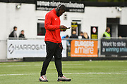 James Alabi of Leyton Orient (27) reads the match day program after arriving at the ground before the Vanarama National League match between Harrogate Town and Leyton Orient at Wetherby Road, Harrogate, United Kingdom on 22 September 2018.