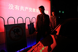 epa06267139 Chinese men walk past an electronic board showing propaganda for the coming 19th National Congress with the words 'Without the Communist Party, there will be no new China' outside a shopping complex in Beijing, China, 15 October 2017. The Communist Party of China (CPC) is making preparations for the five-yearly 19th National Congress scheduled to begin on 18 October. During the Congress, members will elect a new Central Committee, including a new 24-member Politburo and a new seven-member Standing Committee.  EPA-EFE/HOW HWEE YOUNG