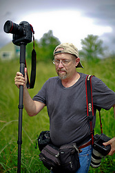 29 August 2014. Lower 9th Ward, New Orleans, Louisiana. <br /> Times Picayune photographer Ted Jackson in the weeds at the Lower 9th Ward on the 9th anniversary of hurricane Katrina.<br /> Photo; Charlie Varley/varleypix.com