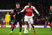 Arsenal Midfielder Ainsley Maitland-Niles (15) tackles Rennes Hatem Ben Arfa (18) during the Europa League round of 16, leg 2 of 2 match between Arsenal and Rennes at the Emirates Stadium, London, England on 14 March 2019.