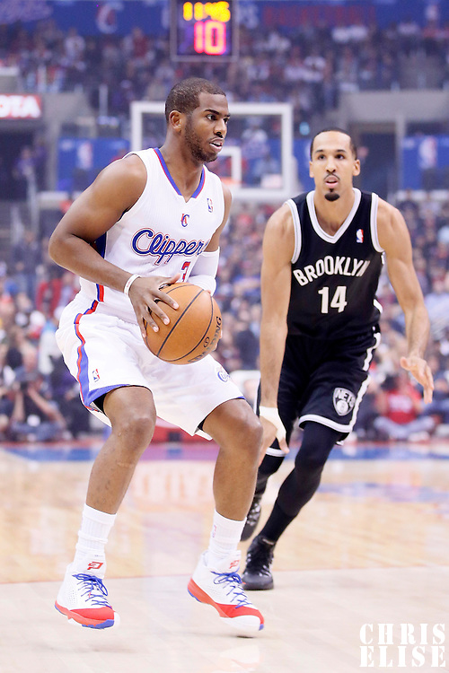 16 November 2013: Los Angeles Clippers point guard Chris Paul (3) drives past `Brooklyn Nets point guard Shaun Livingston (14) during the Los Angeles Clippers 110-103 victory over the Brooklyn Nets at the Staples Center, Los Angeles, California, USA.