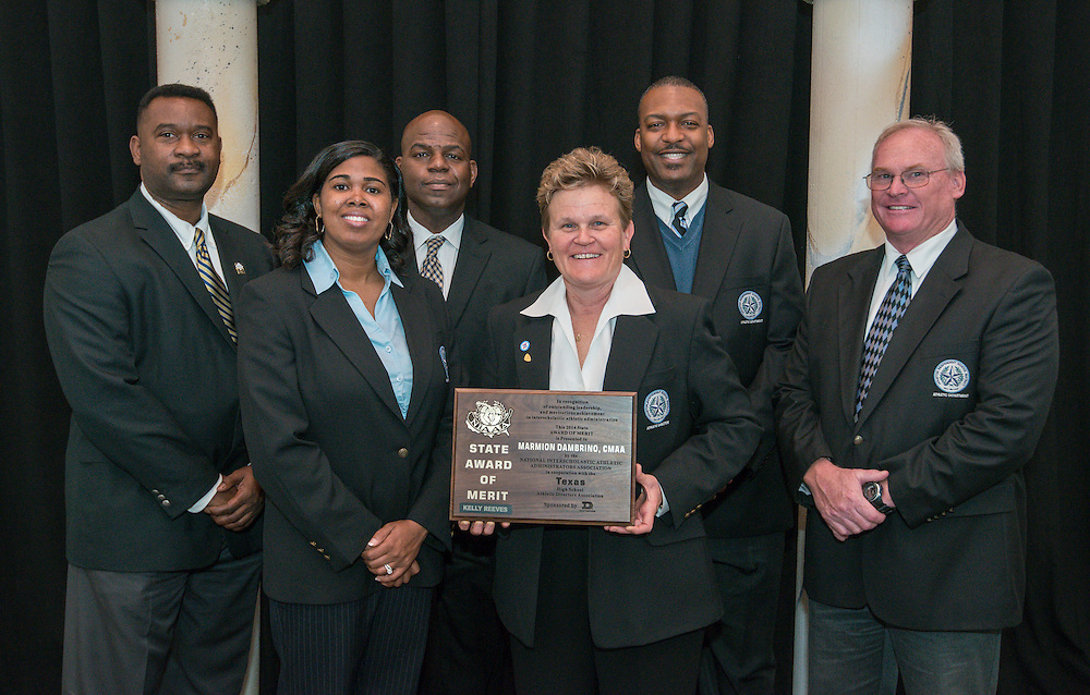 Houston ISD Athletic Director Marmion Dambrino, center, and her staff pose with the NIAAA Kelly Reeves State Award of Merit presented to Dambrino at Texas High School Athletic Directors Association luncheon, March 3, 2014.