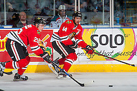 KELOWNA, CANADA - JANUARY 21: Evan Weinger #25 and Keoni Texeira #44 of the Portland Winterhawks move the puck up the ice against the Kelowna Rockets on January 21, 2017 at Prospera Place in Kelowna, British Columbia, Canada.  (Photo by Marissa Baecker/Shoot the Breeze)  *** Local Caption ***
