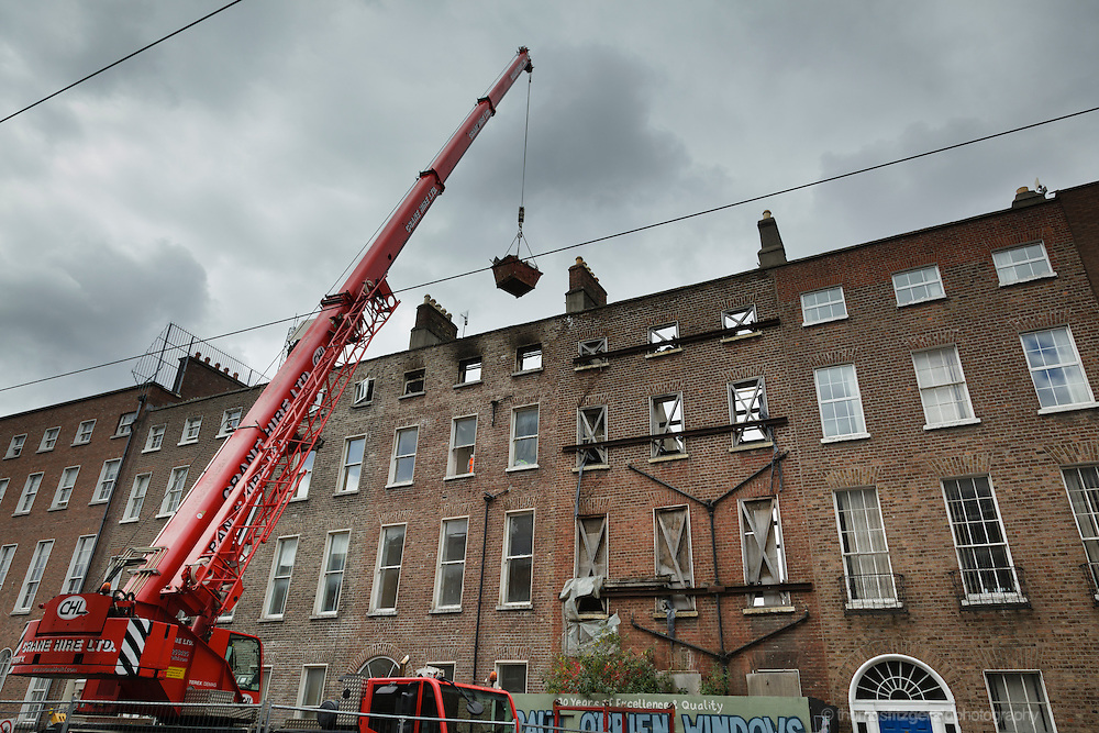 May 16, 2012: Dublin, Ireland: A crane lifts rubble from the burned remains of a building after a fire the previous day on Dublin's Harcourt Street.
