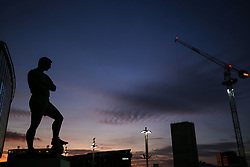 10 November 2017 - International Football Friendly - England v Germany - The Bobby Moore statue and distant building works are silhouetted against the evening sky - Photo: Charlotte Wilson / Offside