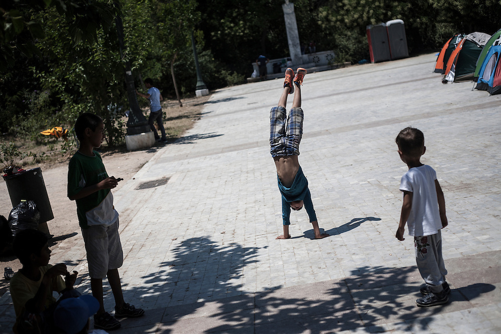 Greece, Athens, July 25th 2015 - Kids playing at Pedion tou Areos park where hundreds of migrants and refugees mostly from Afghanistan have build a temporary camp, after they arrived in Athens from the Greek islands wishing to continue their journey to central Europe.