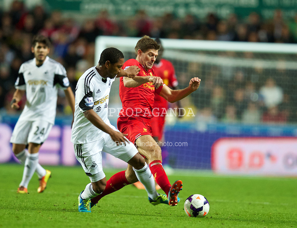 SWANSEA, WALES - Monday, September 16, 2013: Liverpool's captain Steven Gerrard in action against Swansea City during the Premiership match at the Liberty Stadium. (Pic by David Rawcliffe/Propaganda)