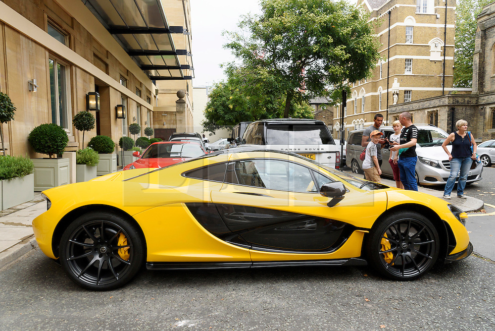© Licensed to London News Pictures. 25/08/2016.  A fleet of supercars including McLaren P1 is parked in Knightsbridge.  The cars are believed to be owned by Quatar Sheikh Khalifa bin Hamad bin Khalifa Al-Thani otherwise know as KHK. London, UK. Photo credit: Ray Tang/LNP