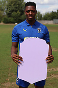 AFC Wimbledon defender Paul Kalambayi (30) holding Fifa sign during the AFC Wimbledon 2018/19 official photocall at the Kings Sports Ground, New Malden, United Kingdom on 31 July 2018. Picture by Matthew Redman.