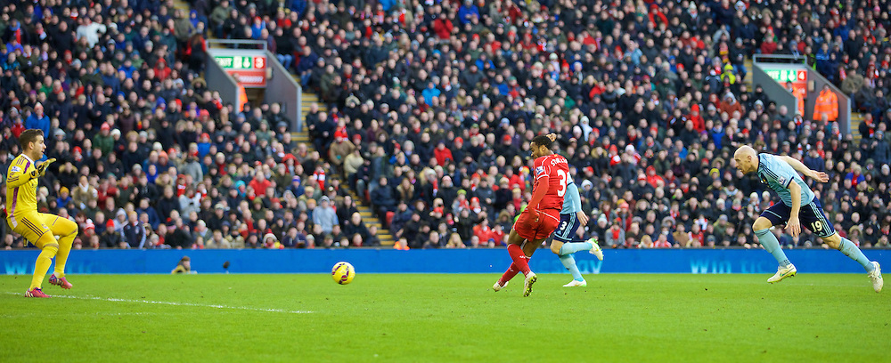LIVERPOOL, ENGLAND - Saturday, January 31, 2015: Liverpool's Raheem Sterling scores the first goal against West Ham United during the Premier League match at Anfield. (Pic by David Rawcliffe/Propaganda)