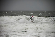 Surfers take advantage of the large waves created by hurricane Sandy at Pine Point in Scarborough, Maine on Monday, Oct. 29, 2012.