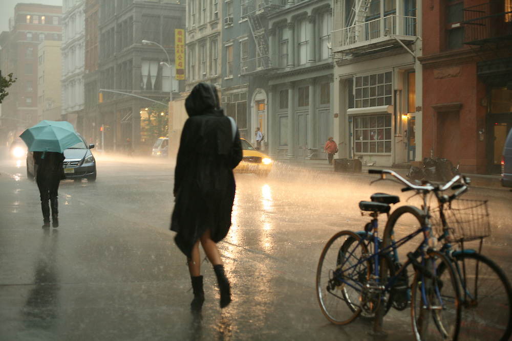 Girl running in stormy weather in New York. 2010