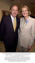 BARONESS BUSCOMBE chairman of Network Art and her husband MR         at an exhibition in London on 28th February 2001.OLR 47