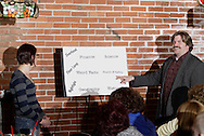 """Jim Wolfrunner (aka Jerry Francis, right) questions an audience member contestant during Mayhem & Mystery's production of """"Are You Brighter Than a Night Light?"""" at the Spaghetti Warehouse in downtown Dayton, Monday, March 15, 2010."""