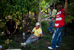 A group of migrants wait outside of a shelter in Tenosique, Tabasco.  Tenosique is the starting point for migrants who will travel on top of a freight train north to the border with the United States.  The trip for these migrants, mostly from Central America,  has become increasingly dangerous over the past several years as Mexico's drug war has raged and kidnappings and killings of migrants has increased.