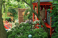 Japanese style garden with red painted tea house