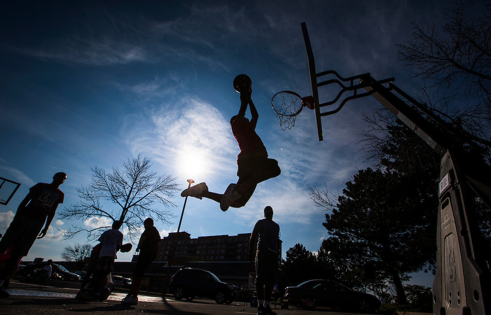 Mississauga , Ontario - August 19, 2015 -- Basketball -- Tristen Mason goes up for a slam dunk on a temporary basketball court set up by the Erin Mills Youth Centre during a community event in a parking lot in Mississauga, Thursday August 19, 2015   (Mark Blinch for the Globe and Mail)