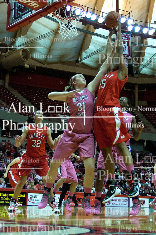 12 February 2012:  Latasha Hollingshed puts up a jump shot over Maddie Oliver during an NCAA women's basketball game Where the Bradley Braves lost to the Illinois Sate Redbirds 82-63.  It was Play 4Kay day in honor of the cancer research fund set up by Coach Kay Yow at Redbird Arena in Normal IL