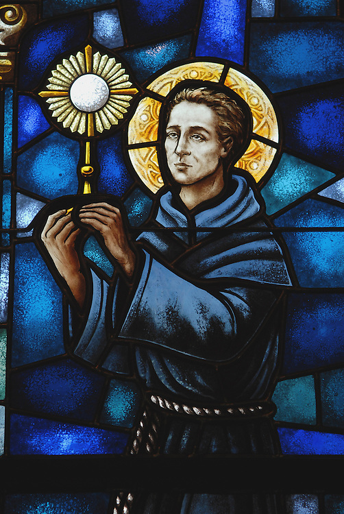 An image of St. Paschal Baylon carrying a monstrance with the Blessed Sacrament, from a stained glass window at the Basilica of St. Josaphat in Milwaukee. (Photo by Sam Lucero)