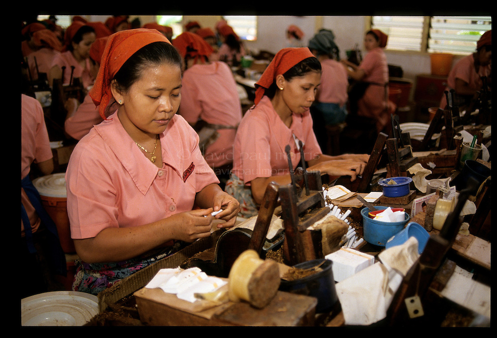 EAST JAVA, INDONESIA: Women work in the Sampoerna clove cigarette factory in East Java of Indonesia. Photograph by David Paul Morris