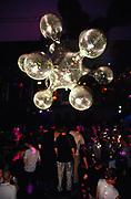 A dancefloor with a futuristic mirror ball, 2000's