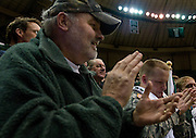 Larry Will of Bellbrook, Ohio and his son Cadet Patrick Will, a junior math education major, applaud the Bobcat's comeback run on Saturday, January 26, 2008 in the Convocation Center. Ohio University beat Ball State University 61-59 on Dads Weekend thanks to junior forward Jerome Tillman's game winning jump-shot with five seconds left.