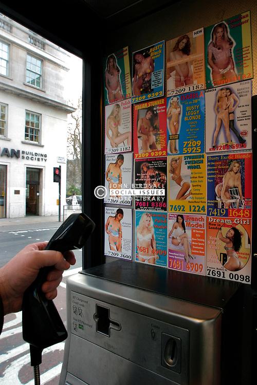 Sex cards in London phone box; UK