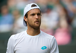 LONDON, ENGLAND - Saturday, July 6, 2019: Joao Sousa (POR) during the Gentlemen's Singles third round match on Day Six of The Championships Wimbledon 2019 at the All England Lawn Tennis and Croquet Club. Sousa won 4-6, 6-4, 7-5, 4-6, 6-4. (Pic by Kirsten Holst/Propaganda)