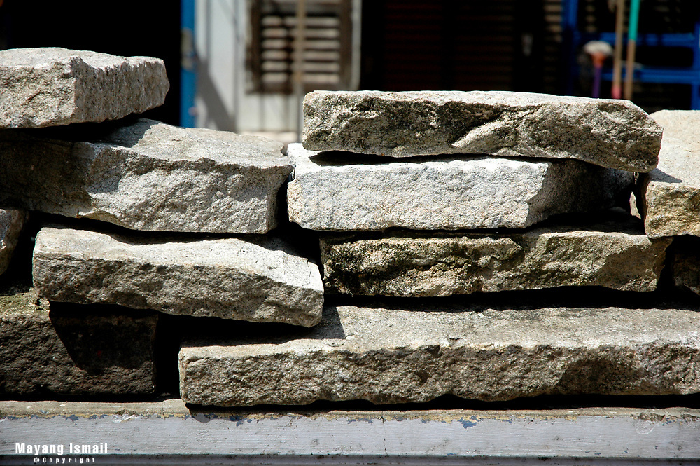 Stone slabs leftover after a construction on the streets of Little India, Singapore