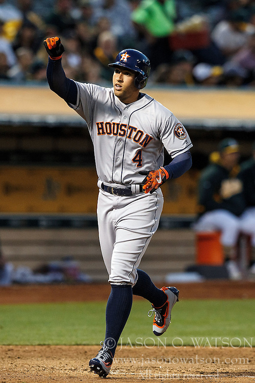 OAKLAND, CA - JULY 19:  George Springer #4 of the Houston Astros celebrates after hitting a home run against the Oakland Athletics during the fifth inning at the Oakland Coliseum on July 19, 2016 in Oakland, California. (Photo by Jason O. Watson/Getty Images) *** Local Caption *** George Springer