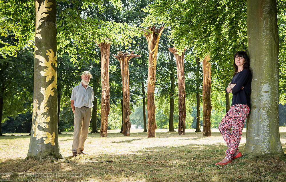 Macedonian artist, Elpida Hadzi-Vasileva, poses beside her sculpture, Resuscitare, an installation of gilded, upside down oak trees positioned in the centre of the beech tree circle at Mottisfont near Romsey, Hampshire. Half of the beech trees in the circle have also been gilded. Ms Hadzi-Vasileva was assisted by forrester John Surplice.