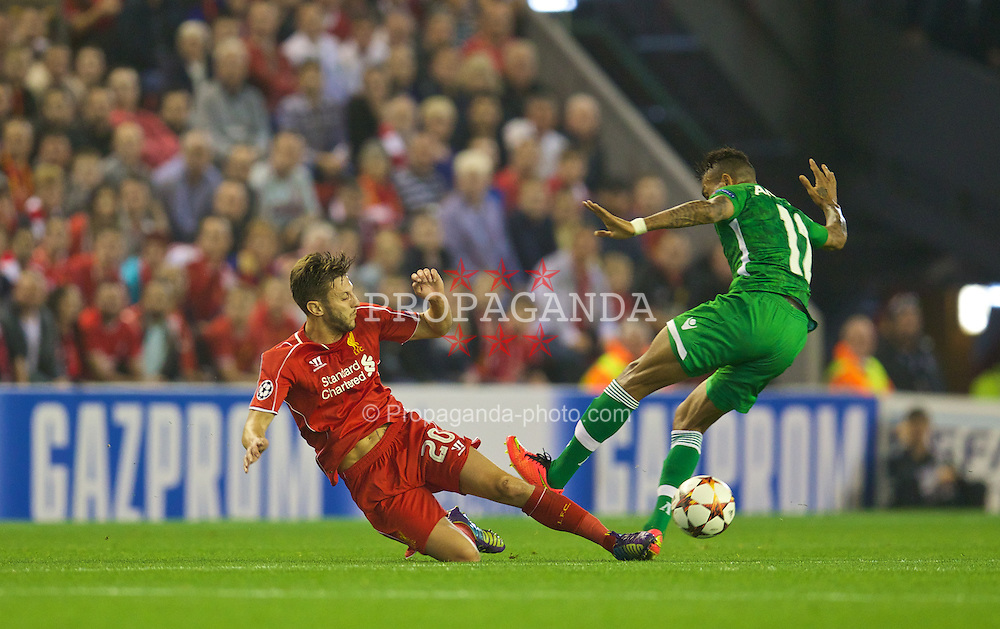 LIVERPOOL, ENGLAND - Tuesday, September 16, 2014: Liverpool's Adam Lallana in action against PFC Ludogorets Razgrad's Anicet Abel during the UEFA Champions League Group B match at Anfield. (Pic by David Rawcliffe/Propaganda)