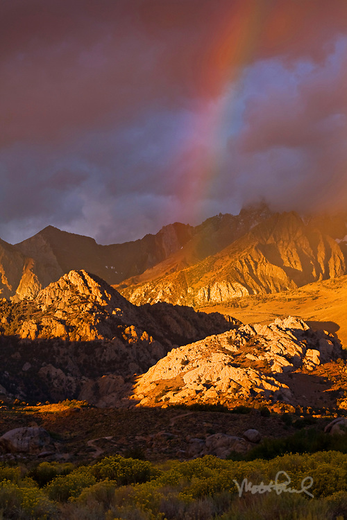 Enjoyed an amazing sunrise in an area called the buttermilks on the western edge of the Owens Valley near Bishop, California At first there was the spectacular alpine glow. Then it started to rain off into the distance creating a rainbow. Then within minutes it was over.