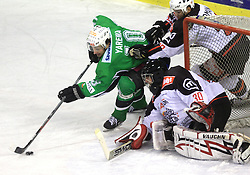 Brendan Yarema vs goalkeeper Gaber Glavic at 39th Round of EBEL League ice hockey match between HDD Tilia Olimpija and Acroni Jesenice, on December 30, 2008, in Arena Tivoli, Ljubljana, Slovenia. Tilia Olimpija won 4:3. (Photo by Vid Ponikvar / SportIda).