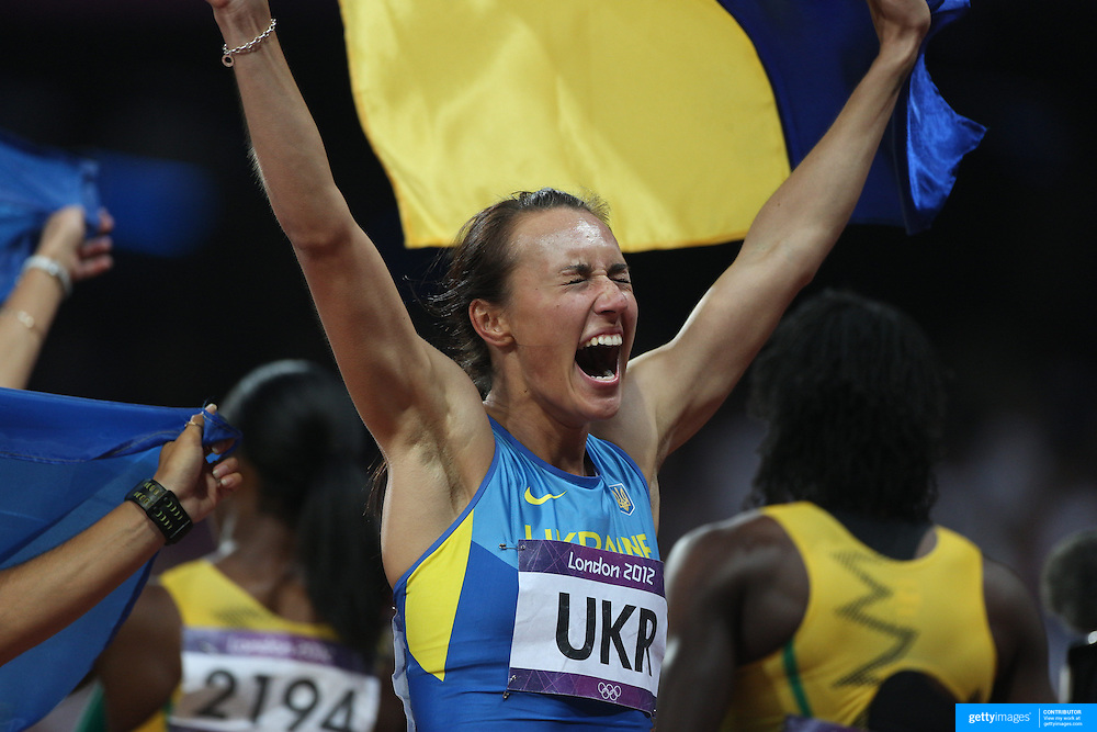 The Ukraine women's 4 x 100m relay team of  Olesya Povh, . Hrystyna Stuy,  Mariya Ryeman, and Elyzaveta Brygina,  celebrate their Bronze Medal at the Olympic Stadium, Olympic Park, during the London 2012 Olympic games. London, UK. 4th August 2012. Photo Tim Clayton