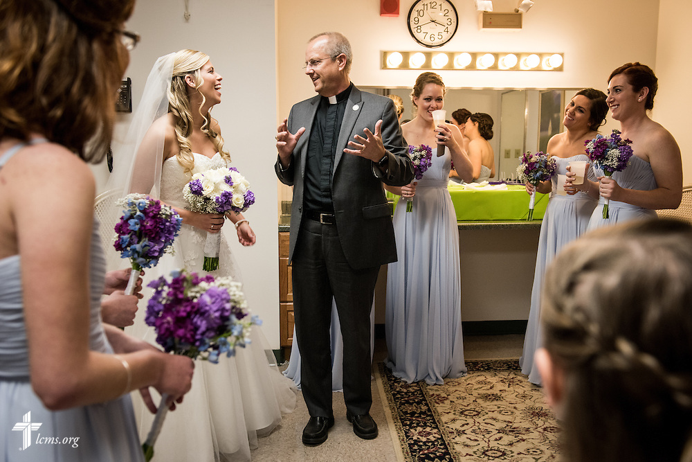 The Rev. Wally Arp, senior pastor of St. Luke's Lutheran Church, talks with bride Toni Vining before her wedding on Saturday, March 5, 2016, in Oviedo, Fla. LCMS Communications/Erik M. Lunsford