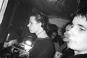 DJ spinning, Dream FM Pirate Radio Benefit, Labyrinth Dalston, London, 1994.