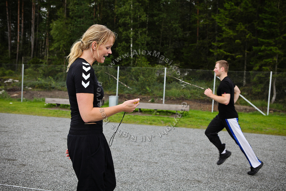 A woman trainer (right) is inciting an inmate to run faster while in the yard of the luxurious Halden Fengsel, (prison) during the time prisoners regularly spend carrying out physical exercise and learning about the human body in Halden, near Oslo, Norway.