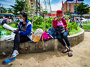 05 JULY 2017 - POIPET, CAMBODIA: Cambodian migrant workers who left Thailand after a crackdown on migrant workers by the Thai government wait for a ride in Poipet. The Thai government proposed new rules for foreign workers recently. The new rules include fines of between 400,000 and 800,00 Thai Baht ($12,000 - $24,000 US) and jail sentences of up to five years for illegal workers and people who hire illegal workers. Hundreds of companies fired their Cambodian and Burmese workers and tens of thousands of workers left Thailand to return to their countries of origin. Employers and human rights activists complained about the severity of the punishment and sudden implementation of the rules. On Tuesday, 4 July, the Thai government suspended the new rules for 180 days and the Cambodian and Myanmar governments urged their citizens to stay in Thailand, but the exodus of workers continued through Wednesday.     PHOTO BY JACK KURTZ