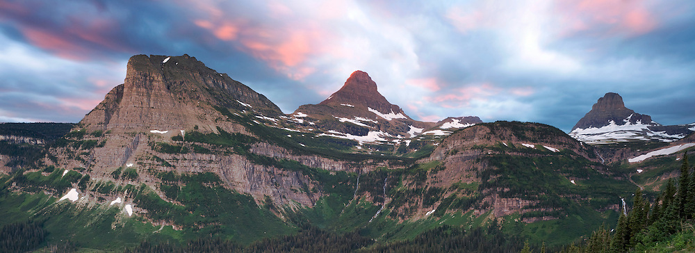 First light of the sun hits the peaks around Logan Pass on the Going to the Sun Road in Glacier National Park, Montana, USA