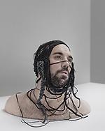 Benoit Foucher is posing in the studio , Paris 2014.         model: Benoiy Foucher hat designer ; Amandine Nagalingam.                         make up and hair: Marie Damperat .                            photographer: Olesya Shilkina .                               asisstant : Anna Muller.