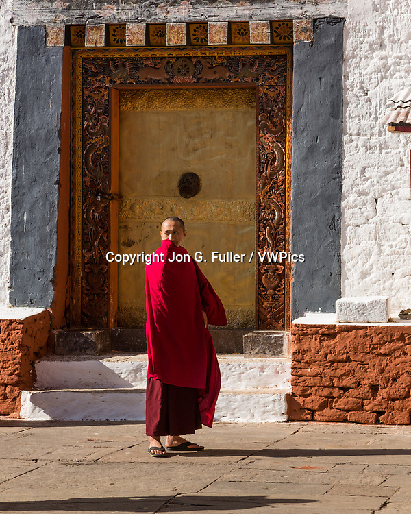 Buddhist monk in the religious courtyard of the Punakha Dzong, Punakha, Bhutan