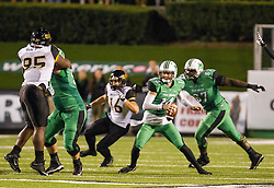 Oct 9, 2015; Huntington, WV, USA; Marshall Thundering Herd quarterback Chase Litton scrambles in the pocket during the third quarter against the Southern Miss Golden Eagles at Joan C. Edwards Stadium. Mandatory Credit: Ben Queen-USA TODAY Sports