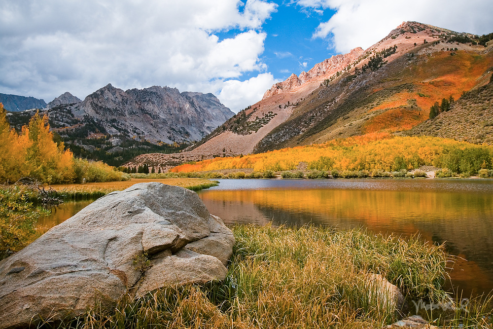 Colorful autumn aspen colors surround the shores of North Lake with the Sierra Crest beyond.