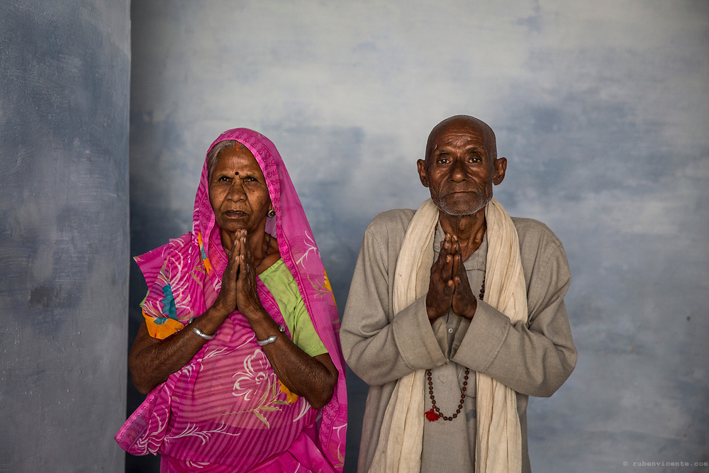 Couple praying in a temple of Mathura. India
