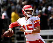 Sep 15, 2019; Oakland, CA, USA; Kansas City Chiefs quarterback Patrick Mahomes (15) drops back for a pass in the first half against Oakland Raiders at Oakland-Alameda County Coliseum. The Chiefs defeated the Raiders 28-10..(Gerome Wright/Image of Sport)
