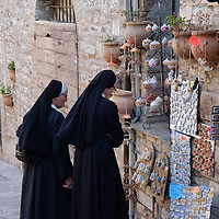 ASSISI, ITALY - OCTOBER 03:  Two nuns look at souvenirs in  Assisi ahead of the visit of Pope Francis on October 3, 2013 in Assisi, Italy. Pope Francis is due to venerate the tomb of San Francesco of Assisi tomorrow during his one-day visit to the city.  (Photo by Marco Secchi/Getty Images)